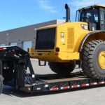 Transporting Heavy Machinery on Landoll Trailer
