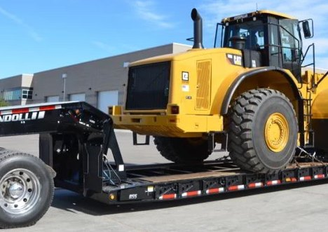 Transporting Heavy Machinery on Landoll Trailer