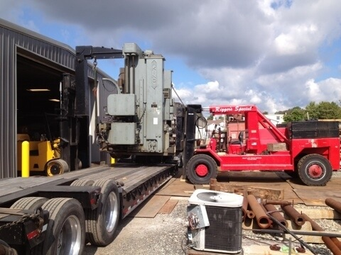 Equip Trucking Delivering a Large Metalworking Machine